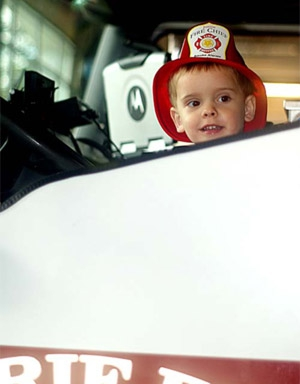 Boy in a firetruck