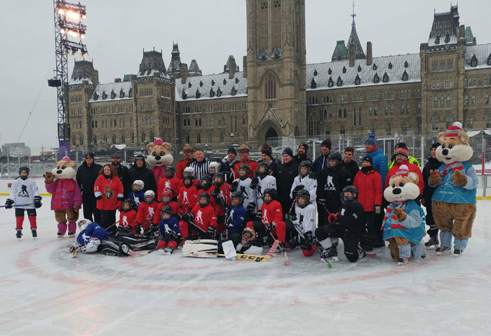 CECCE students with hockey equipment on Parliament Hill