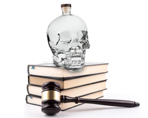 Crystal head Vodka with judge's gavel